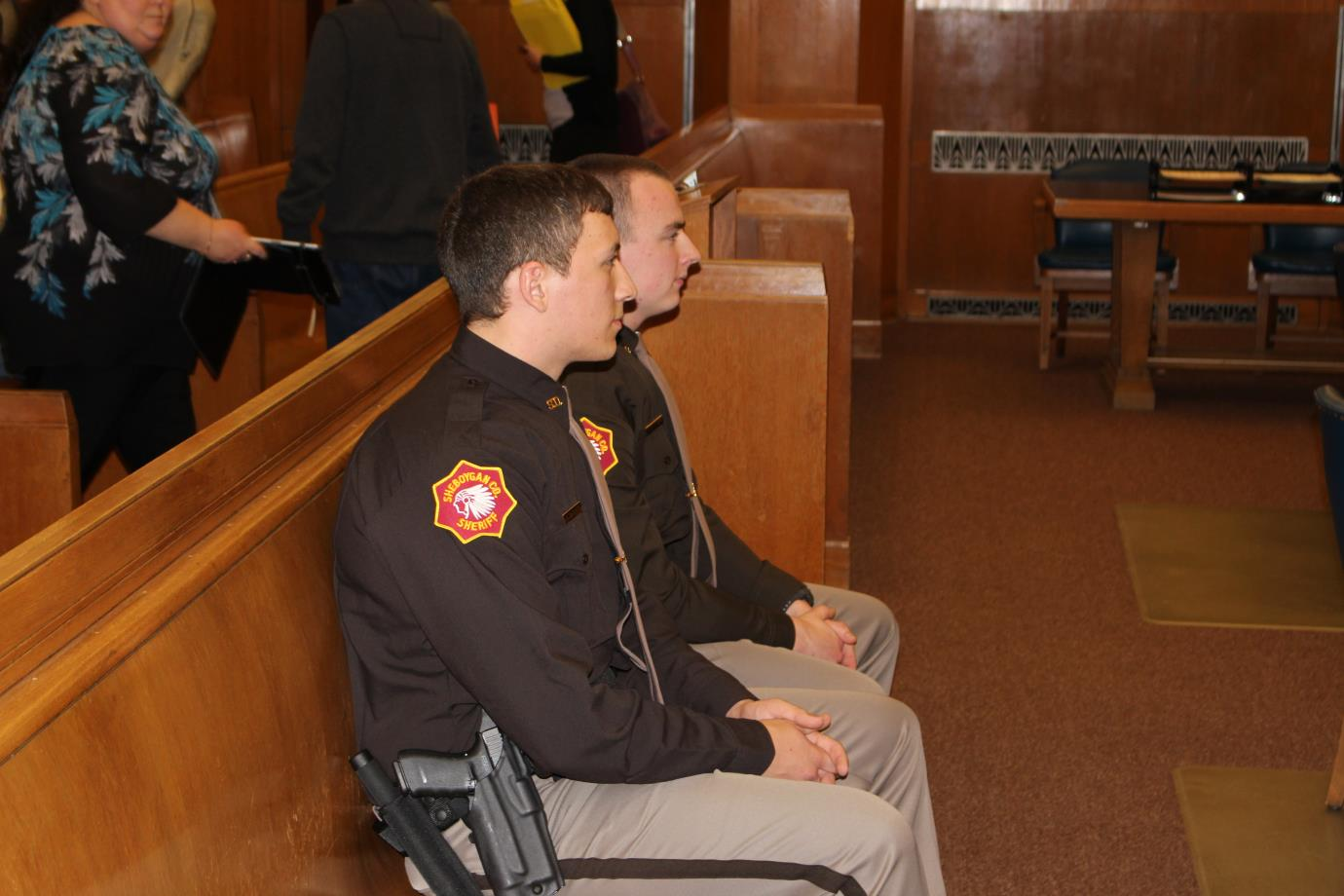 Officers waiting patiently at the front of the courtroom