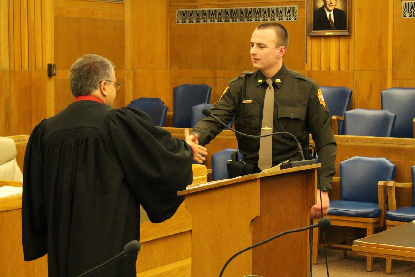 Handshake in the courtroom
