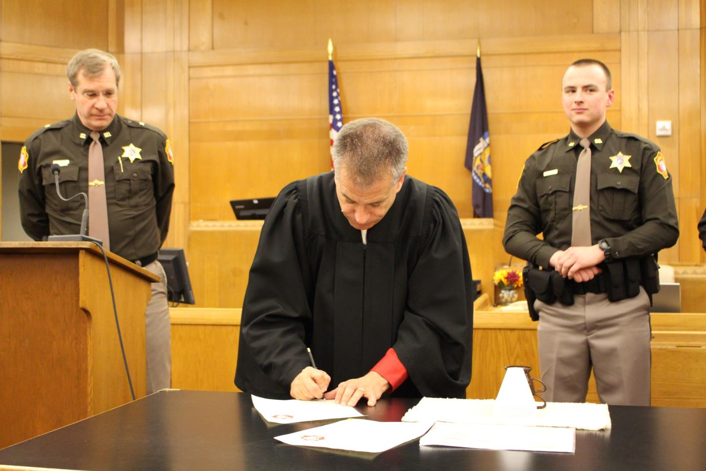 Signing documents in the courtroom