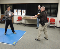 officer instructs attendee in self-defense