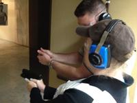 officer demonstrates proper shooting posture
