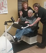 Rocky Knoll staff working with patient on VibeTech equipment