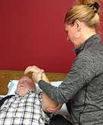 Therapy Services - Staff working with patient arm therapy