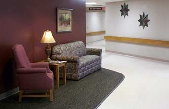Comfortable seating is available in the hallway. A perfect place to sit down and visit.